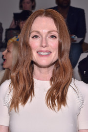 Julianne Moore was casually coiffed with this center-parted wavy 'do during the Ralph Lauren fashion show.