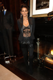 This sharp black blazer added a heavy dose of sophistication to Halle's see-through beaded top.