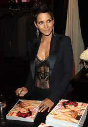 Halle Berry signed her cover issue of Vogue Magazine at the Ralph Lauren Celebration of Fashion's Night Out wearing an oxidized sterling silver and rose cut diamond Eagle ring.
