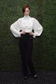 Coco Rocha went Victorian in a ruffled white Ralph Lauren blouse with voluminous sleeves at the screening of 'To Catch a Thief.'