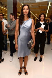 Padma Lakshmi capped off her ensemble with a gray crocodile clutch with snakeskin detailing.