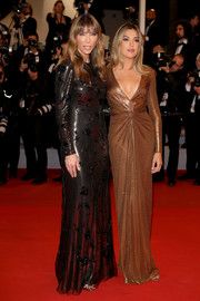 Sistine Rose Stallone was sexy-glam in a plunging gold chainmail gown by Ralph Lauren at the 2019 Cannes Film Festival screening of 'Rambo: Last Blood.'