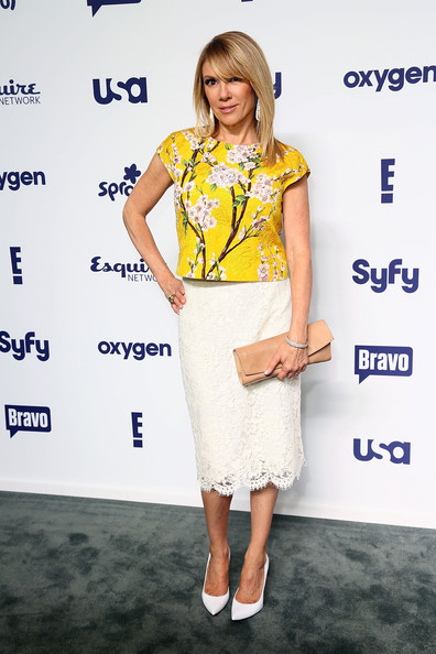 Ramona Singer Patent Leather Clutch [entertainment upfronts,nbcuniversal cable,nbcuniversal cable entertainment upfronts,clothing,fashion model,yellow,shoulder,fashion,hairstyle,footwear,joint,dress,fashion design,new york city,the jacob k. javits convention center,ramona singer]