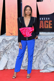 Naomie Harris went bold in a black Gucci blazer with oversized fuchsia bow detail and crystal trim at the European premiere of 'Rampage.'