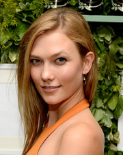 Karlie Kloss attended the Raspoutine Paris Pop-Up event wearing an unstyled side-parted 'do.