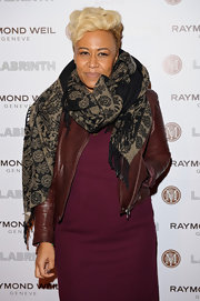 Singer Emeli Sande rugged-up in style, layering a snug scarf over her leather jacket and dress ensemble.