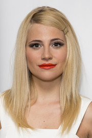 Pixie Lott added a splash of color with a swipe of bright red lipstick.