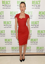 Maggie Q sheathed her slender figure in a tight-fitting red dress by Roland Mouret for the React to Film Awards.