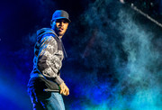 Chris Brown hit the stage at The Forum in a classic black baseball cap and printed hoodie.