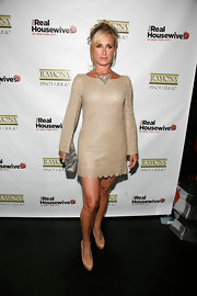 Sonja dons a beaded gold tunic dress with a scalloped hem for the Real Housewives season premiere party in NY.