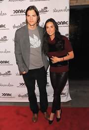 Demi Moore posed with Ashton at the 'Real Men Don't Buy Girls' launch party in a striped turtleneck sweater and leather leggings.