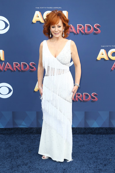 Reba McEntire Fringed Dress [flooring,beauty,shoulder,joint,fashion model,gown,lady,carpet,hairstyle,dress,arrivals,reba mcentire,nevada,las vegas,mgm grand garden arena,academy of country music awards]