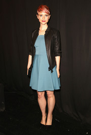A black leather jacket provided an edgy-chic finish to Valorie Curry's cute blue dress at the Rebecca Minkoff fashion show.