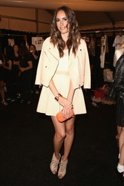 Louise Roe attended the Rebecca Minkoff fashion show wearing a moto-chic pink and white skirt suit.