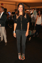 Rebecca Minkoff completed her get-up with a pair of gray lace-up peep-toe booties adorned with colorful tassels.