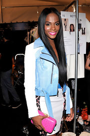 Tika Sumpter was in the mood for pastels at the Rebecca Minkoff fashion show, pairing a pink ostrich leather clutch with her blue and white skirt suit.