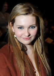 Abigail Breslin attended the Rebecca Minkoff fall 2012 fashion show wearing her long tresses sleek and straight.