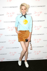 Coco Rocha teamed her top with a tan suede mini skirt by Rebecca Minkoff.