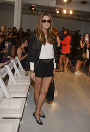 Olivia Palermo looked cute with a bit of an edge in black tweed shorts and a studded jacket during the Rebecca Taylor fashion show.