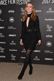 Zoey Deutch completed her all-black attire with a pair of Josie Natori tights.