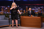Rebel Wilson teamed red velvet pumps with a black sequin dress for her appearance on 'Jimmy Fallon.'