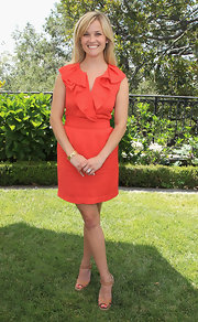Reese Witherspoon kept her ruffled orange shift summery with a pair of tan leather espadrille Almeria wedges.