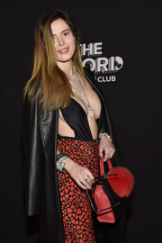 Bella Thorne attended the On the Record Speakeasy and Club grand opening carrying a cute black and red pompom-embellished bag by Les Petits Joueurs.