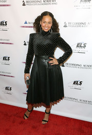 Alicia Keys teamed her top with a pleated leather skirt.