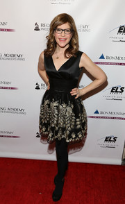 Lisa Loeb donned a black cocktail dress with a lace skirt for the Grammy Week event.