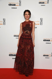 Olga Kurylenko kept it fun yet glam in a sheer club-motif gown by Christian Dior at the 2018 Cesar Film Awards.