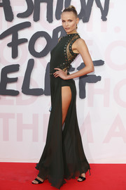 Natasha Poly oozed sex appeal wearing this high-slit, lace-panel gown by Elie Saab at the Fashion for Relief Cannes 2018.