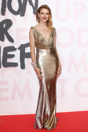 Natalia Vodianova was a shimmering beauty in a plunging gold column dress at the Fashion for Relief Cannes 2018.
