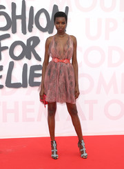 Maria Borges attended the Fashion for Relief Cannes 2018 wearing a belted pink cocktail dress by Azzedine Alaïa.