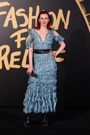 Karen Elson toughened up her look with a pair of studded black boots.