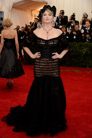 Kate Upton went for a flirty Met Gala look with this sheer black Dolce & Gabbana off-the-shoulder gown featuring lacy tiers from top to bottom.