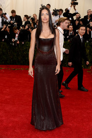 Adriana Lima was edgy-glam on the Met Gala red carpet in a brown leather-bodice gown by Givenchy.