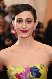 Emmy Rossum added a lovely pop of color with a swipe of rich red lipstick.