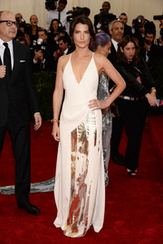 Cobie Smulders was sultry-edgy at the Met Gala in a low-cut white Reed Krakoff halter dress with gold accents on the skirt.
