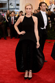 Kristen Wiig rocked a black Balenciaga fishtail dress with a pair of slacks during the Met Gala.