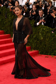 Beyonce Knowles went for total drama at the Met Gala in this beaded, sheer Givenchy Couture number.