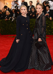 Ashley Olsen cut a regal figure at the Met Gala in a floor-sweeping navy coat dress by Gianfranco Ferre.