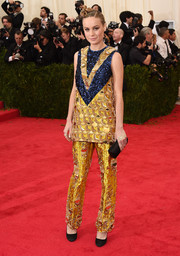 Brie Larson completed her unique, striking outfit with a pair of embellished gold silk pants, also by Prada.
