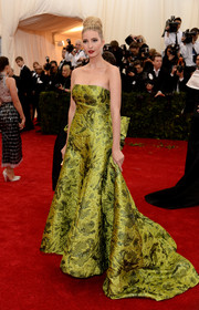 Ivanka Trump attended the Met Gala wearing an opulent green strapless gown by Oscar de la Renta.