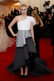 Greta Gerwig went for an ultra-modern vibe at the Met Gala in a Theory by Olivier Theyskens tricolor gown featuring an asymmetrical bodice and a voluminous skirt with a high-low hem.
