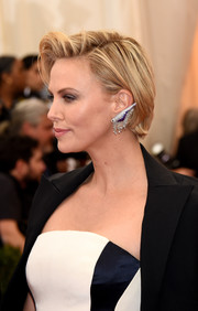 Charlize Theron wore her short hair teased at the front for a cool Met Gala red carpet look.