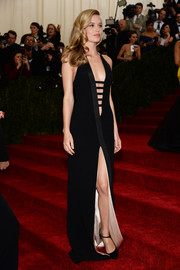 Georgia May Jagger was smoking-hot on the Met Gala red carpet in a black Thierry Mugler evening dress with a navel-baring neckline and a thigh-high slit.