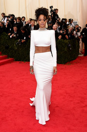 Rihanna contrasted her strong-silhouette top with a flowy white skirt, also by Stella McCartney.