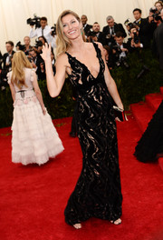 Gisele Bundchen sent temperatures rising in a see-through black lace and velvet gown by Balenciaga during the Met Gala.