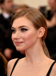 Imogen Poots styled her hair into a low, side-parted ponytail for the 2014 Met Gala.