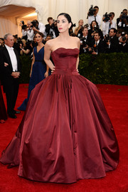 Sarah Silverman was all dolled up in a burgundy Zac Posen strapless gown with a voluminous skirt during the Met Gala.